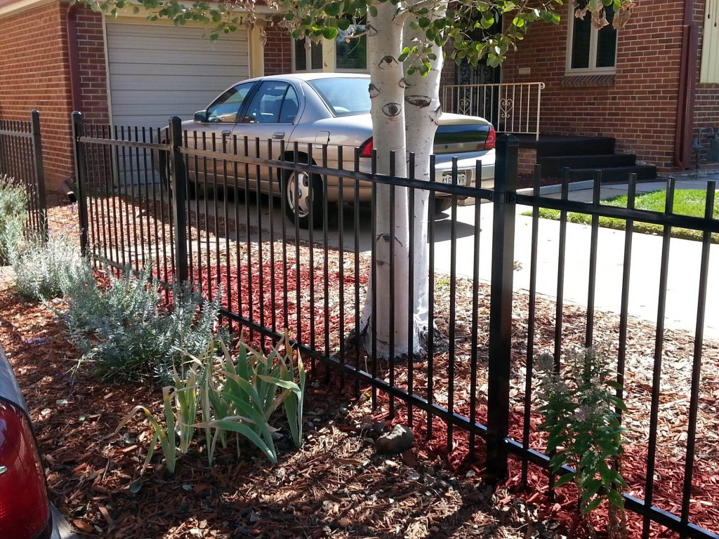 Metal Black Fence on a driveway by Boundary Fence Supply Denver, CO